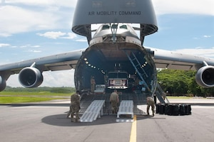 U.S. Airmen assigned to 22nd Airlift Squadron, Travis Air Force Base, California, unload cargo from a C-5M Super Galaxy in support of a Denton Program mission July 26, 2020, at Managua, Nicaragua. The aircrew delivered a fire truck, ambulance, furniture, sewing material, agricultural supplies and educational material to Nicaragua. (Courtesy photo)