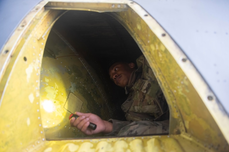 Airman inside aircraft compartment