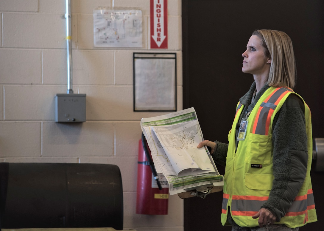 Staff Sgt. Courtney Kohnke performs a post-earthquake inspection on a facility at Joint Base Elmendorf-Richardson, Alaska in January 2019.