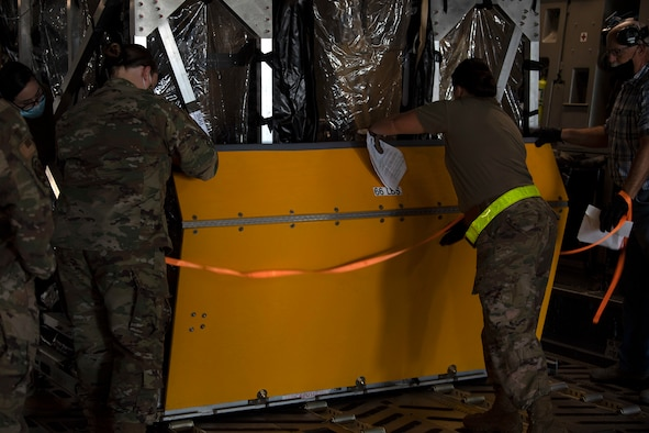 photos of a TIS unit and Airmen securing it to an aircraft