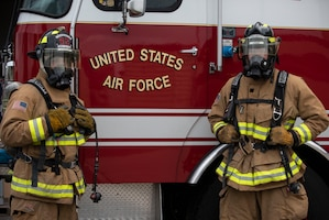 U.S. Air Force Senior Airman Brandon LaValla and Airman 1st Class Brandon Franklin, 52nd Civil Engineer Squadron Fire and Emergency Services firefighters, pose for a photo at Spandahlem Air Base, Germany, July 24, 2020. LaValla and Franklin demonstrated their capabilities by saving a victim from a distressed vehicle on their way home from training and ensured the safety of the victim and bystanders. (U.S. Air Force photo by Senior Airman Melody W. Howley)
