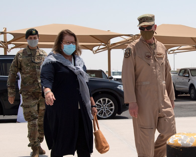 U.S. Air Force Lt. Gen. Gregory Guillot, U.S. Air Forces Central Command commander, greets U.S. Ambassador Greta Holtz, Chargè d'Affaires at the U.S. Embassy in Qatar, during her visit to the Combined Air Operations Center at Al Udeid Air Base, Qatar, July 30, 2020.