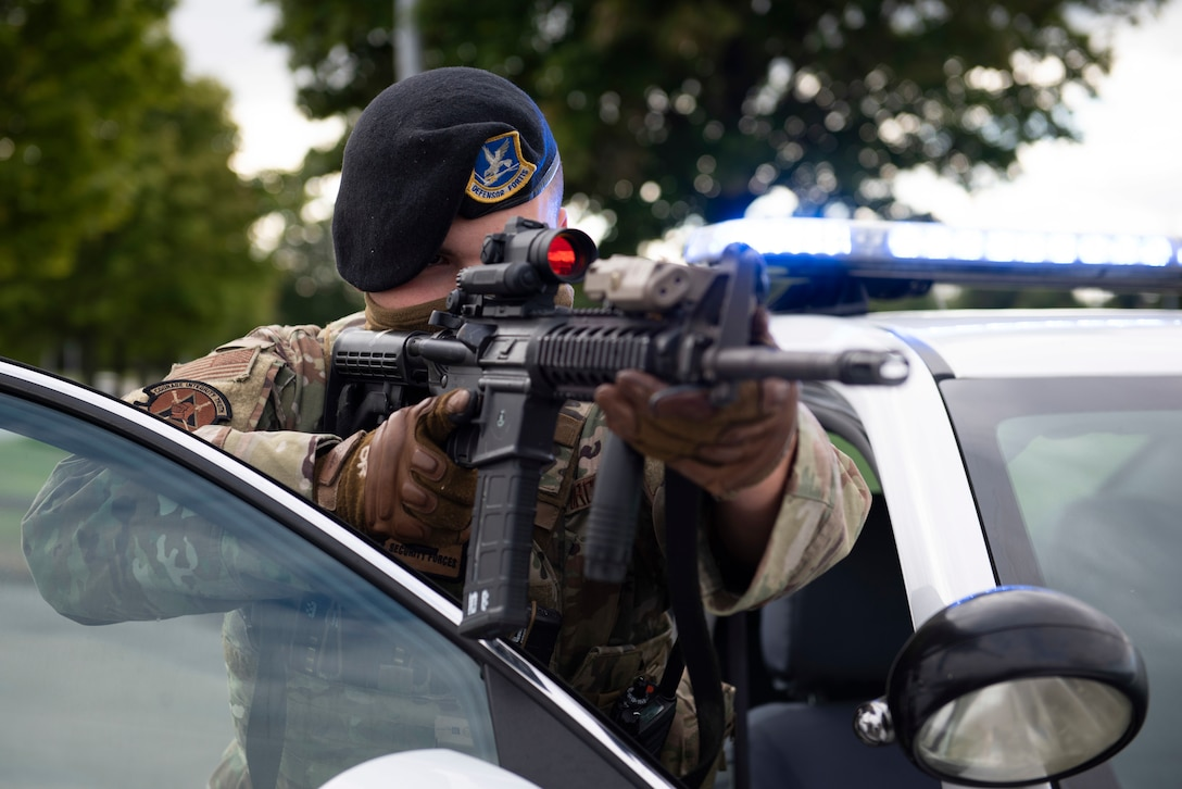 U.S. Air Force Senior Airman Josten Lacey, 423rd Security Forces Squadron (SFS) patrolman, conducts a high risk vehicle challenge during a training exercise at RAF Molesworth, England, July 28, 2020. 423rd SFS defenders conduct regular training and exercises to ensure mission readiness. (U.S. Air Force photo by Airman 1st Class Jennifer Zima)