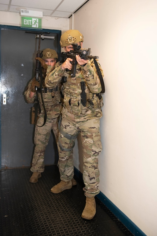 U.S. Air Force Senior Airman Josten Lacey, left, and Staff Sgt. Derek Ricks, right, 423rd Security Forces Squadron (SFS) patrolmen, clear a building during a simulated active shooter training at RAF Molesworth, England, July 28, 2020. 423rd SFS defenders conduct regular training and exercises to ensure mission readiness. (U.S. Air Force photo by Airman 1st Class Jennifer Zima)
