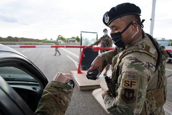 U.S. Air Force Senior Airman Isaiah Bailen, 423rd Security Forces Squadron (SFS) patrolman, scans a common access card at entry gate during a simulated training at RAF Molesworth, England, July 28, 2020. 423rd SFS defenders conduct regular training and exercises to ensure mission readiness. (U.S. Air Force photo by Airman 1st Class Jennifer Zima)