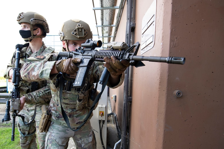 U.S. Air Force Staff Sgt. Derek Ricks, left, and Senior Airman Josten Lacey, right, 423rd Security Forces Squadron (SFS) patrolmen, clear a building during a simulated active shooter training at RAF Molesworth, England, July 28, 2020. 423rd SFS defenders conduct regular training and exercises to ensure mission readiness. (U.S. Air Force photo by Airman 1st Class Jennifer Zima)