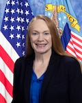 official photo of Stacey Pilling with American flag and DLA flag in background.