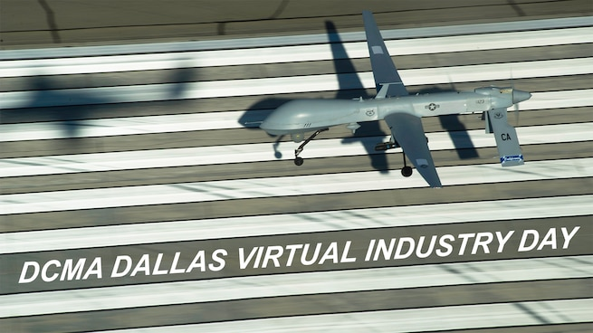 A large grey military drone aircraft takes off