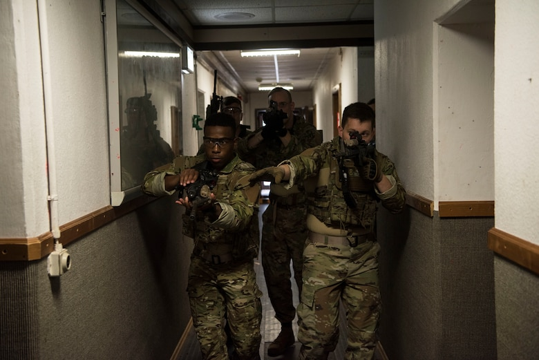 U.S. Air Force Airmen assigned to the 435th Security Forces Squadron practice building clearing techniques during close quarters battle training.
