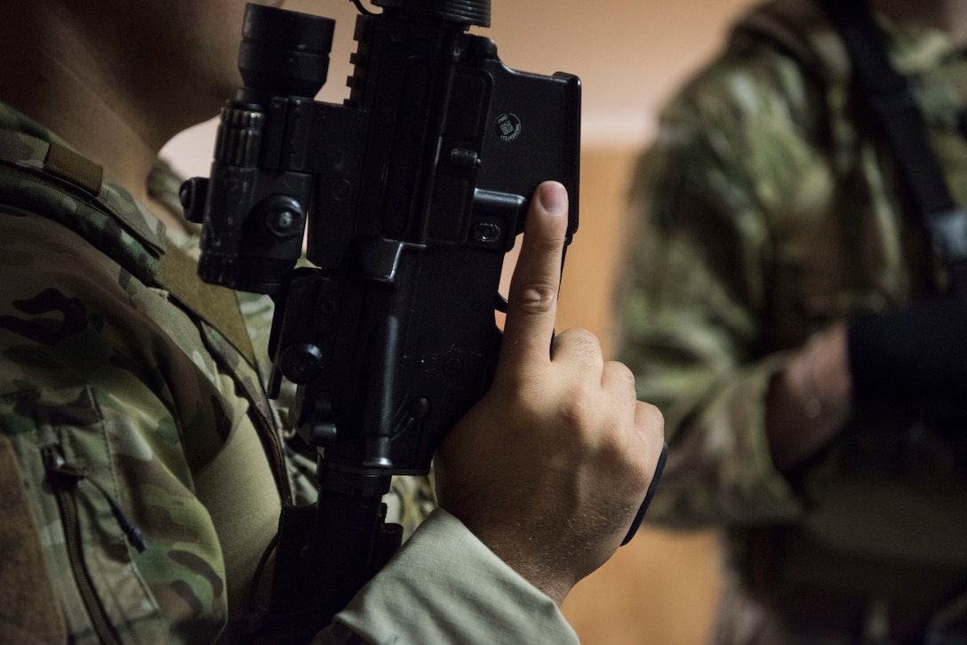 A U.S. Air Force Airman assigned to the 435th Security Forces Squadron practices trigger discipline during close quarters battle training.