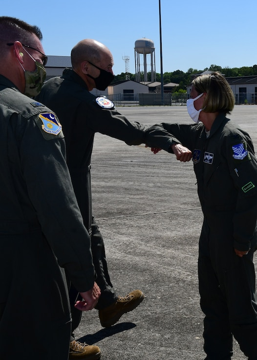 U.S. Air Force Col. Amy Holbeck, 116th Air Control Wing commander, Georgia Air National Guard, welcomes Gen. Mike Holmes, commander of Air Combat Command, to Team JSTARS at Robins Air Force Base, Georgia, July 20, 2020. Holmes is responsible for organizing, training, equipping and maintaining combat-ready air, space, cyber and intelligence forces for rapid deployment and employment while ensuring strategic air defense forces are ready to meet the challenges of peacetime air sovereignty and wartime defense. (U.S. Air National Guard photo by Barry Bena)