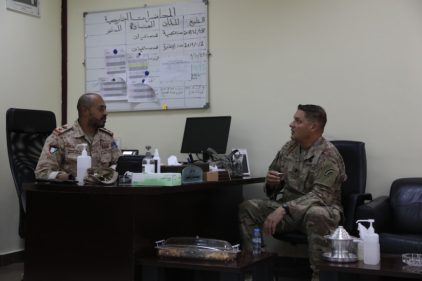 U.S. Army Lt. Col. Michael Rodriguez speaks with Kuwait Land Forces Lt. Col  Meshal Alrubiaan during a meeting in Kuwait on July 20, 2020. The meeting was  held to lay the groundwork and planning for subject matter expert exchanges  between the United States Army and the Kuwait Land Forces.