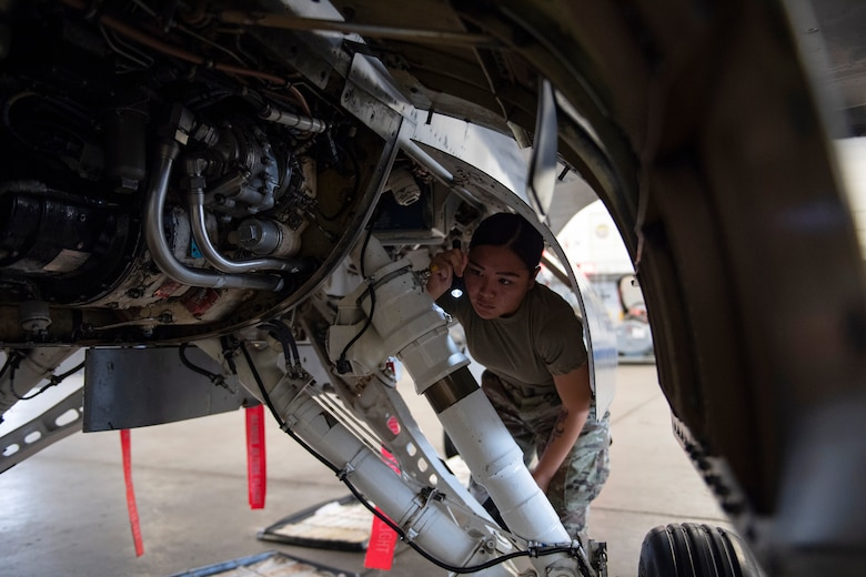 Airman performs maintenance check on F-16