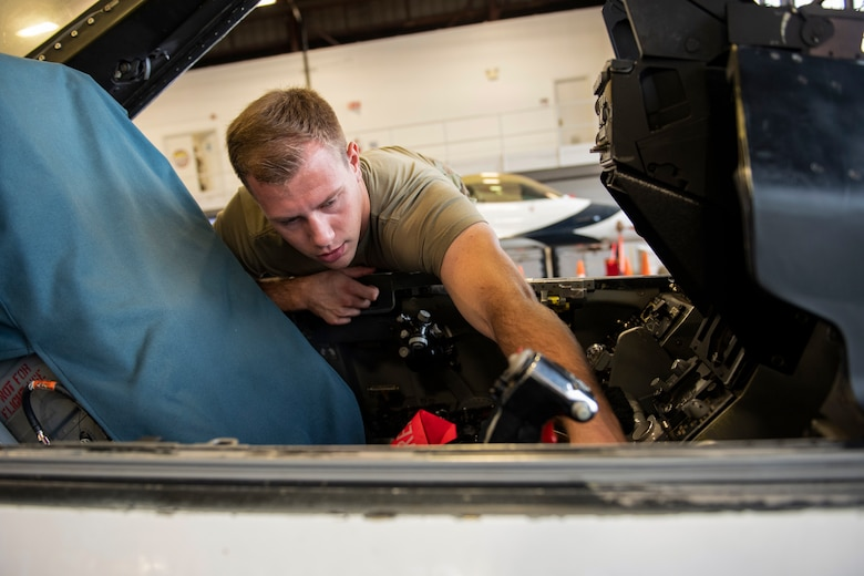 Airman performs safe-for-maintenance check on F-16