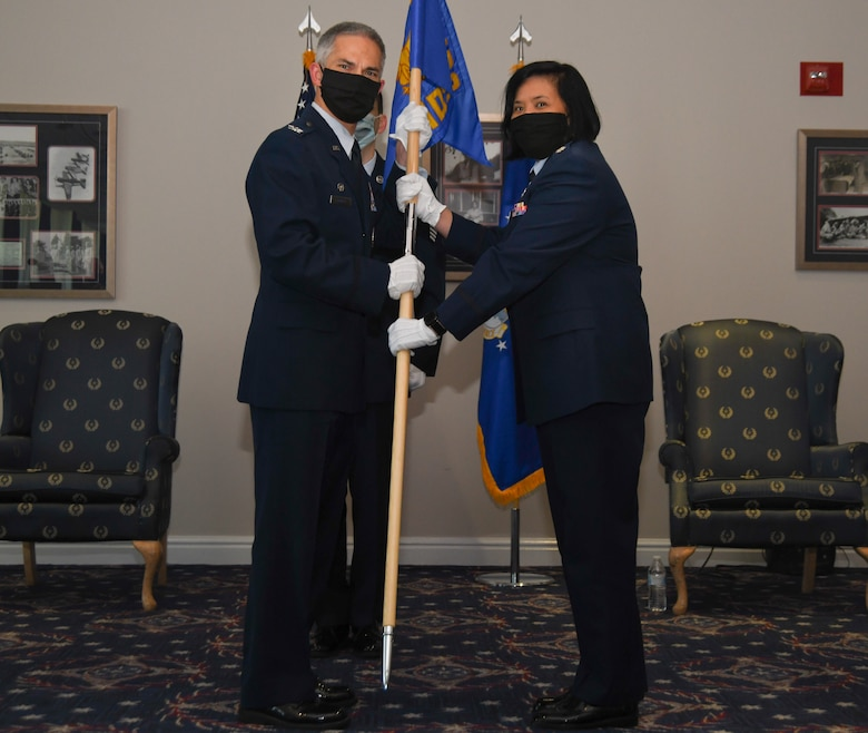 Col. Jason J. Lennen, 316th Medical Group commander, passes the guidon to Lt. Col. Marie-Antonette C. Brancato, who assumes command of the 316th Medical Squadron during a change of command ceremony at Joint Base Anacostia-Bolling, Washington, D.C., July 29, 2020.