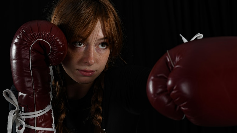 Senior Airman Sarah Jane Gruber, a broadcast journalist for the 910th Public Affairs Office, poses for a photo in her boxing attire, July 11, 2020, Youngstown Air Reserve Station. Gruber competes in Women's Amateur Boxing for USA Boxing's Great Lakes Region and has trained in boxing for four years.
