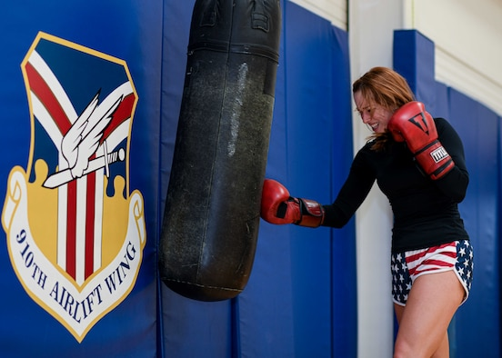 Senior Airman Sarah Jane Gruber, a broadcast journalist for the 910th Public Affairs Office, throws a right uppercut to a heavy bag, July 11, 2020, Lt. Col. H. James English Memorial Fitness Center, Youngstown Air Reserve Station. Gruber competes in Women's Amateur Boxing for USA Boxing's Great Lakes Region and has trained in boxing for four years.