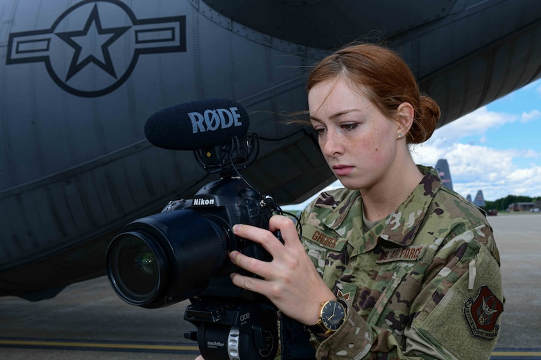 Senior Airman Sarah Jane Gruber, a broadcast journalist for the 910th AW,  checks her camera settings on the Youngstown Air Reserve Station's flightline. Broadcast journalists are responsible for ethically documenting the wings mission and producing visual information products in order to tell the Air Force Story.