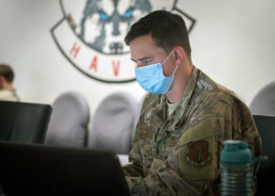 Tech. Sgt. Bryan Dauphinais, 103rd Communications Flight cyber transport journeyman, analyzes simulated cyberattacks during exercise Cyber Yankee at the Windsor Locks Readiness Center, Windsor Locks, Connecticut, July 30, 2020.