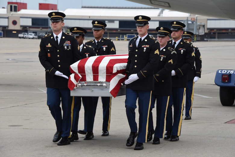 The Pennsylvania National Guard's Military Funeral Honors detail conducts a dignified transfer of remains for U.S. Army Cpl. Jackey Dale Blosser on July 30, 2020, at Pittsburgh International Airport. Blosser, of Randolph County, West Virginia, went missing in action on Dec. 2, 1950, during the Korean War. (U.S. Air National Guard Photo by Senior Master Sgt. Shawn Monk)