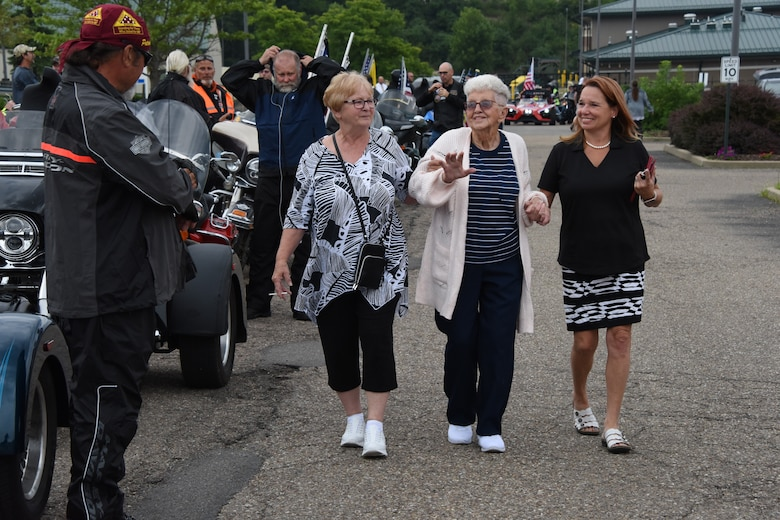 Relatives of U.S. Army Cpl. Jackey Dale Blosser, from left, Linda Koss, Bonnie Shingleton who is Cpl. Blosser's Sister, and Kimberly White, say thank you to members of the Patriot Guard Riders who provided vehicle escort for the funeral procession near Pittsburgh on July 30, 2020. Blosser, of Randolph County, West Virginia, went missing in action in Korea Dec. 2, 1950, during the Korean War. (U.S. Air National Guard Photo by Senior Master Sgt. Shawn Monk)