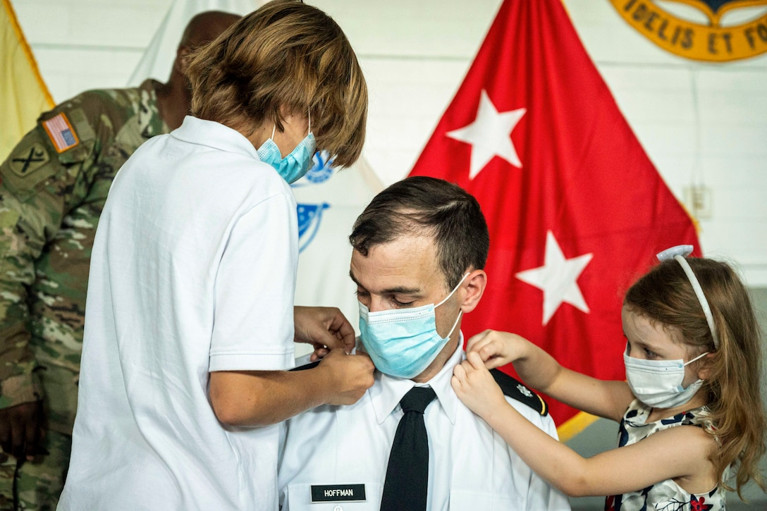 Two children pin a soldier.