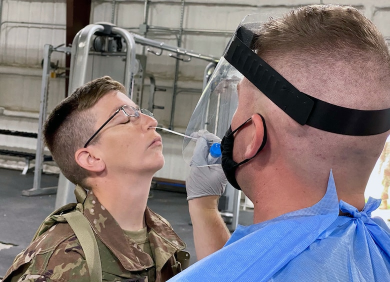 A soldier with the 28th Expeditionary Combat Aviation Brigade receives a test for COVID-19 at a mobilization station at Fort Hood, Texas, July 9, 2020.