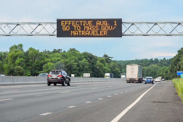 A digital sign above Route 128 announces the Massachusetts' new travel order July 31. As a result, base officials updated the Hanscom Travel Policy.