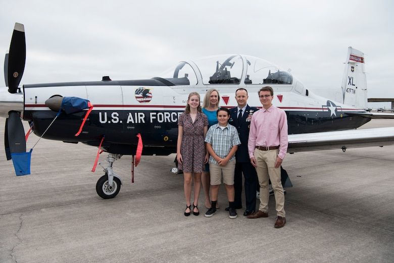 Col. Craig D. Prather, 47th Flying Training Wing commander, and his family stand in front of a T-6 Texan II before the virtual wing change of command ceremony at Laughlin Air Force Base, Texas, July 31, 2020. Prather takes command after serving as the commander of the 1st Joint Special Operations Air Component at Fort Bragg, N.C. (U.S. Air Force photo by Senior Airman Marco A. Gomez)