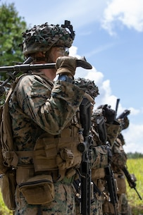 U.S. Marines with Company E, 2d Battalion, 2d Marine Regiment (V22), 2d Marine Division, prepare to execute a supported live-fire range at Fort A.P. Hill, Virginia, July 24, 2020. Marines with V22 are training in a simulated realistic setting and environment to improve combat effectiveness and readiness. (U.S. Marine Corps photo by Lance Cpl. Reine Whitaker)