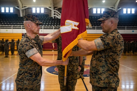 U.S. Marine Corps Col. Gregory L. Jones, right, relinquishes command of Headquarters Battalion, 2d Marine Division to Col. Kemper A. Jones during a change of command ceremony on Camp Lejeune North Carolina, July 24, 2020. The ceremony represents the transfer of authority, responsibility, and accountability from the outgoing officer to the incoming commanding officer. (U.S. Marine Corps photo by Lance Cpl. Patrick King)