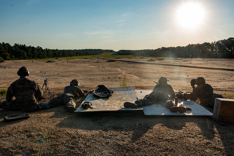 Photo of Airmen attending an M24 sniper rifle qualification and proficiency training session.