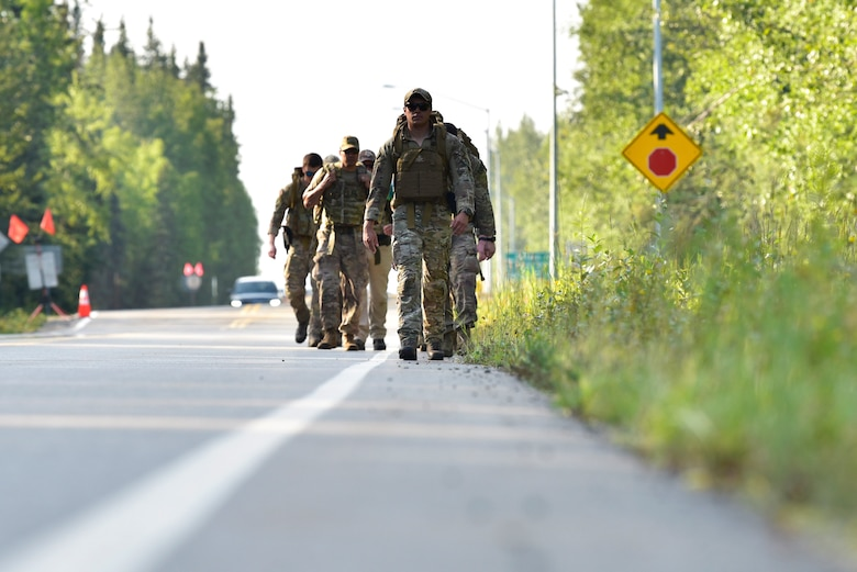 U.S. Airmen from the 354th Civil Engineer Squadron Explosive Ordnance Disposal (EOD) flight ruck outside of Eielson Air Force Base, Alaska, July 31, 2020. The Eielson EOD flight annually rucks from Eielson AFB to the Arctic Circle in honor of 32 EOD Airmen who paid the ultimate sacrifice. (U.S. Air Force photo by Senior Airman Beaux Hebert)