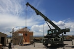 Soldiers from the 947th Engineer Company, Colorado Army National Guard, work on a new shed for the Montrose readiness center, Montrose, Colorado, July 20, 2020. The engineer company built a structure that will be used for future training purposes and completed construction tasks for the readiness center as part of their two week annual training.  (U.S. Army National Guard photo by Staff Sgt. Joe Labutka)