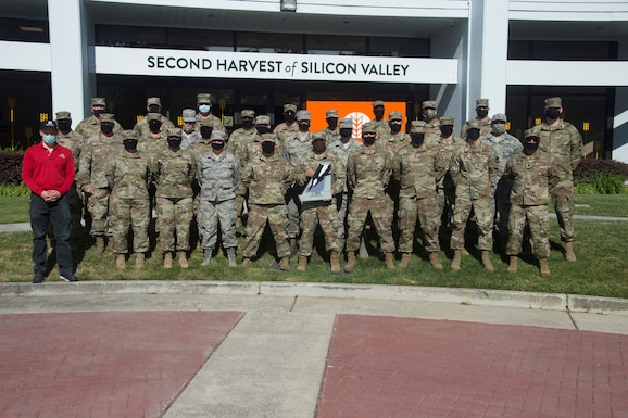 144th Fighter Wing Airmen who served at the Second Harvest Food Bank of the Silicon Valley stand to take a photo in San Jose, California, June 3, 2020