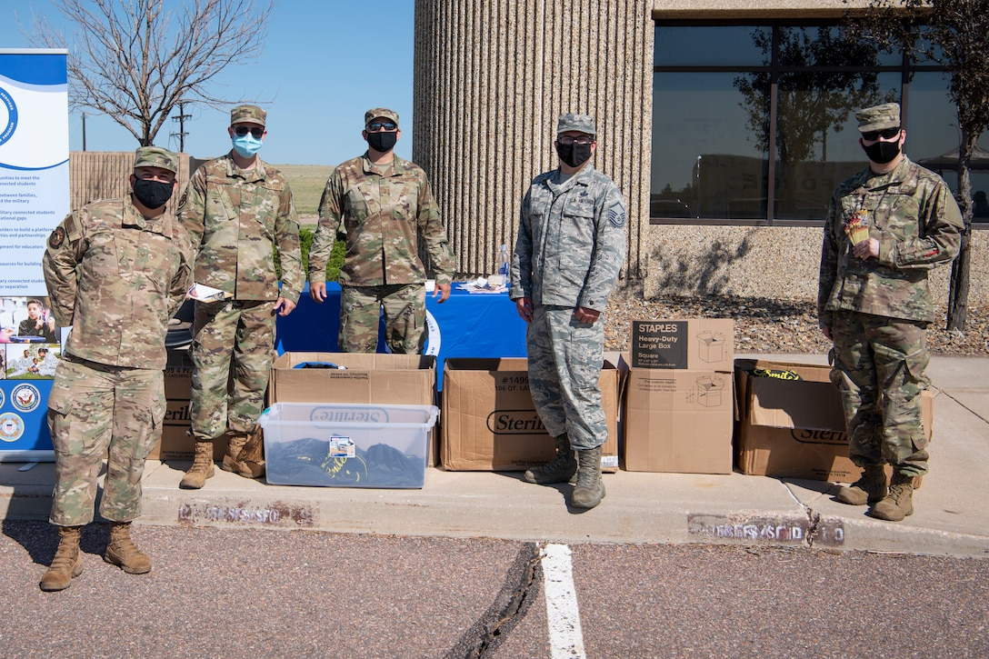 Airmen from the 17th Test Squadron, 50th Security Forces Squadron and the 4th Space Operations Squadron volunteered at a school liaison hosted back-to-school drive July 31, 2020, at Schriever Air Force Base, Colorado. The Airmen handed out school supplies to families. (U.S. Air Force photo by Airman 1st Class Jonathan Whitely)