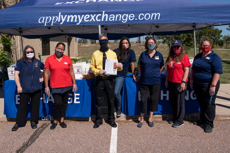 Employees from the Army and Air Force Exchange Service volunteered to give out free school supplies during a back-to-school drive July 31, 2020, at Schriever Air Force Base, Colorado. AAFES handed out free pencils, sunglasses, tissues, coloring books and more to Schriever families. (U.S. Air Force photo by Airman 1st Class Jonathan Whitely)