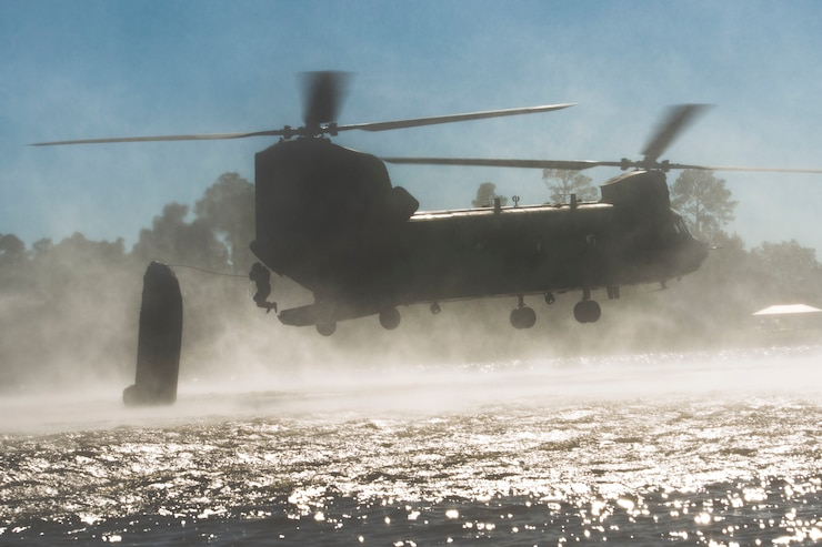 U.S. and Chilean Army Special Forces Soldiers perform a helocast over Big Lake in Gulfport, Mississippi during Southern Strike 18, Oct. 25, 2017. Southern Strike 18 is a total force, multi-service training exercise hosted by the Mississippi Air National Guard's Combat Readiness Training Center in Gulfport, Mississippi from Oct. 23 through Nov. 3, 2017.