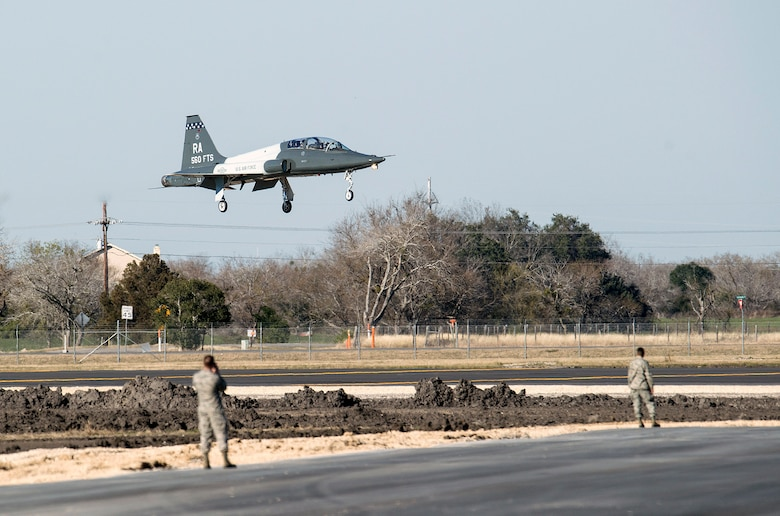 A T-38C Talon lands at the Joint Base San Antonio-Seguin Auxiliary Airfield during a ribbon-cutting event signifying the reopening of the airfield Jan. 20, 2015, after completion of a three-year construction project. The airfield continues to serve the 12th Flying Training Wing's mission while meeting the challenges posed by the novel coronavirus pandemic.