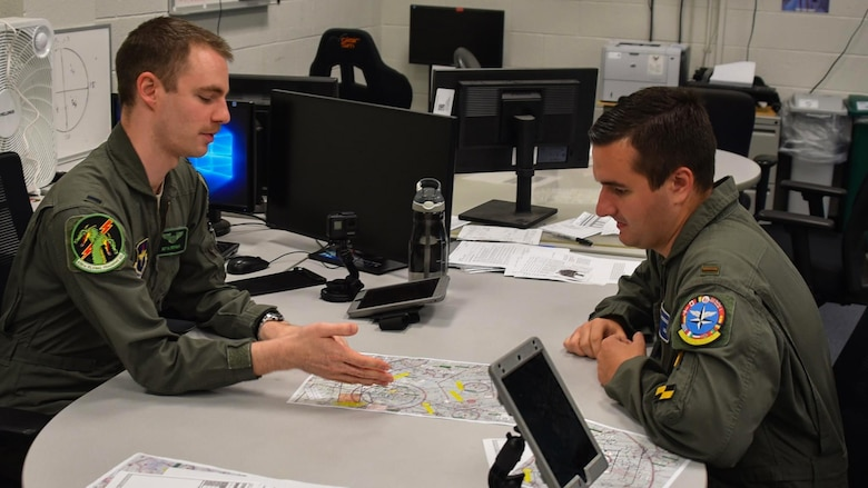 Instructor pilot briefs student