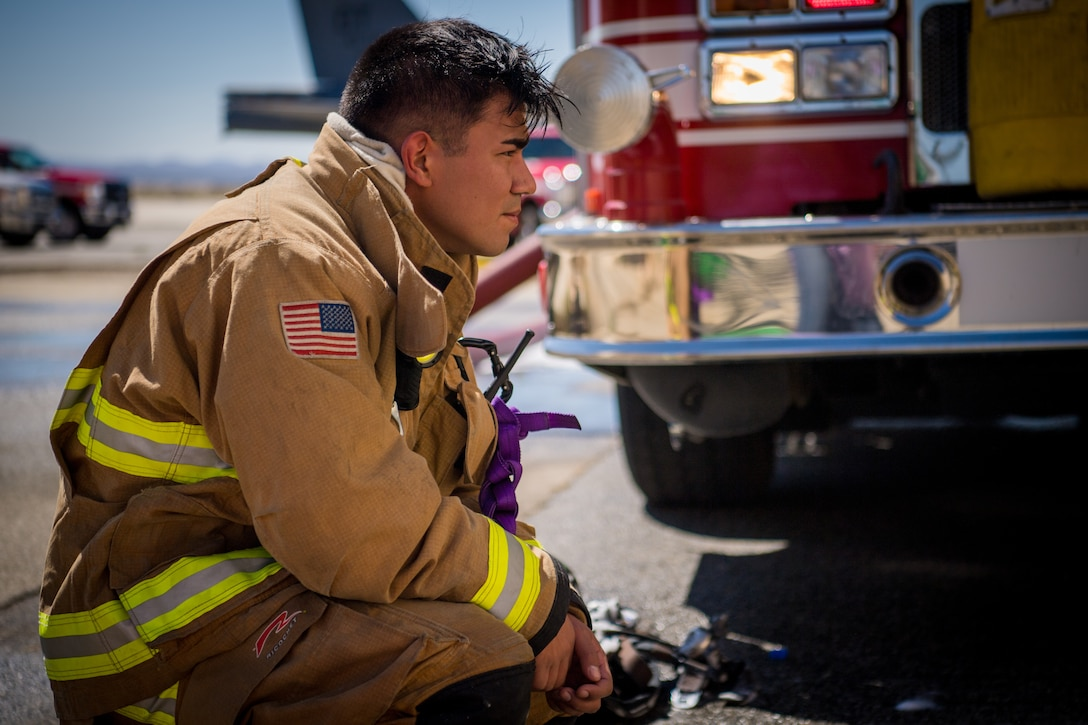 Firefighter Senior Airman Rene Rosas takes a break following search and rescue training at a recently remodeled hangar at Edwards Air Force Base, California, July 23. The unique training opportunity provided the firefighters a mentally and physically demanding training scenario. (Air Force photo by Chris Dyer)