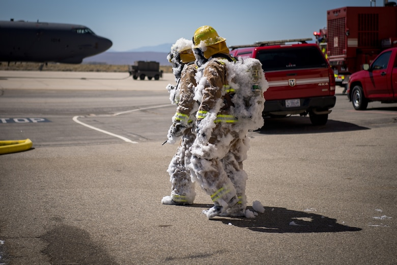 Firefighters from the Edwards Air Force Base Fire and Emergency Services conduct search and rescue training at recently remodeled hangar at Edwards Air Force Base, California, July 23. The unique training opportunity provided the firefighters a mentally and physically demanding training scenario. (Air Force photo by Chris Dyer)