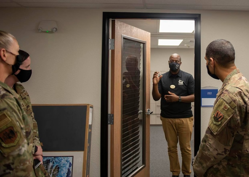 Col. Jason Bell, 432nd Wing/432nd Air Expeditionary Wing vice commander, right, and Col. Dina Quanico, left, 432nd Mission Support Group commander, tour the newly renovated consolidated support center at Creech Air Force Base.