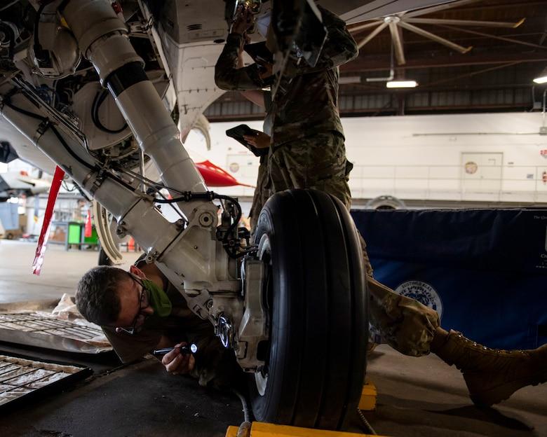Airman check brakes on F-16