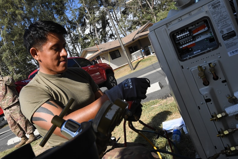 A photo of U.S. Air Force Tech. Sergeant Andre Chamilco, 624th Civil Engineer Squadron Heating Ventilation and Air Conditioning, repairing a local unit for facility repairs at Bellows Air Force Station, Hawaii, July 22, 2020, during the unit's Annual Training. The U.S. Air Force Reserve's 624th CES provided necessary repairs at Bellows AFS, a Military Welfare and Recreation facility that supports military families and communities, to improve infrastructure and increase individual readiness skills. (U.S. Air Force photo by Tech. Sgt. Garrett Cole)
