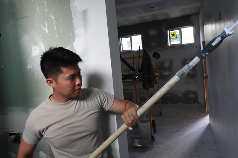 A photo of U.S. Air Force Staff Sgt. Siu Au, 624th Civil Engineer Squadron Operations Management Specialist, applying paint for facility repairs at Bellows Air Force Station, Hawaii, July 22, 2020, during the unit's Annual Training. The U.S. Air Force Reserve's 624th CES provided necessary repairs at Bellows AFS, a Military Welfare and Recreation facility that supports military families and communities, to improve infrastructure and increase individual readiness skills. (U.S. Air Force photo by Tech. Sgt. Garrett Cole)