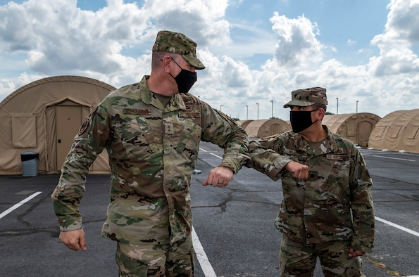 Maj. Gen. William Spangenthal, vice commander of Air Education and Training Command, elbow bumps Lt. Col. Damien Williams, 37th Training Group deputy commander, during an immersion tour June 24, 2020, at JBSA-Lackland, Texas.