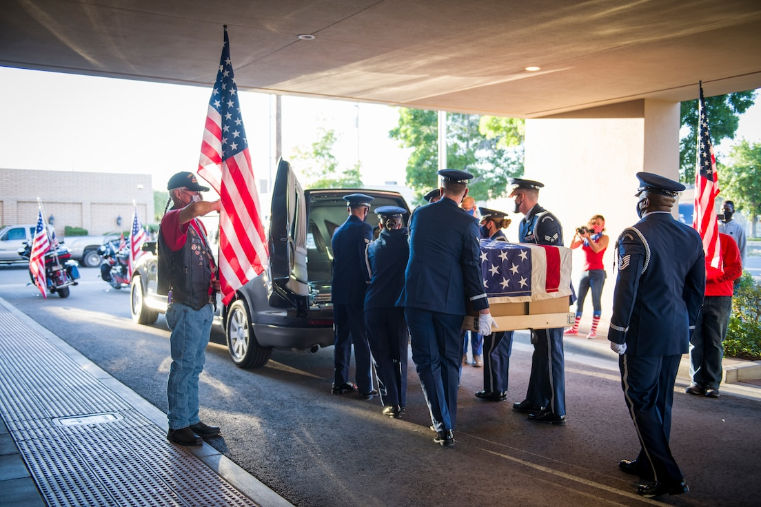 Members of the 412th Test Wing bid farewell to Senior Airman Cody Chrisman during a dignified transfer ceremony in Lancaster, California, July 31.