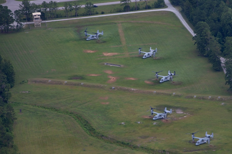 MV-22B Ospreys with Marine Medium Tiltrotor Squadron 266, VMM-162, VMM-261, and VMM-263, 2nd Marine Aircraft Wing, land during Exercise Deep Water 2020 at Marine Corps Air Station New River, N.C., July 29, 2020. The purpose of the exercise is to increase 2nd Marine Aircraft Wing's interoperability and readiness on a scale that simulates peer-level threats. (U.S. Marine Corps photo by Lance Cpl. Elias E. Pimentel III)