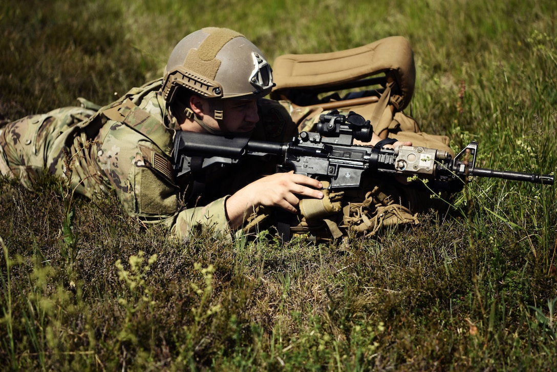 A U.S. Airman assigned to the 435th Contingency Response Group holds an M-4 carbine assault rifle while securing a landing zone during exercise Agile Wolf 20-04.